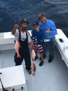 kid charter fishing for mingos in Destin, FL